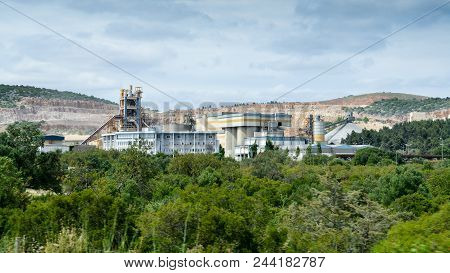 A Huge And Working Cement Production Plant Production Factory On Mining Quarry. Heavy Indusrty With