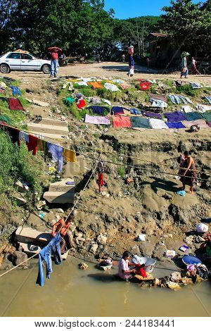 Mandalay, Myanmar - December 30: Unidentified People Wash Clothes In Ayeyarwady River On December 30