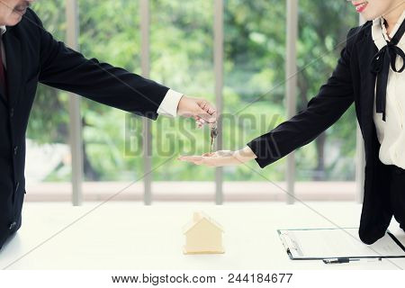 Real Estate Agent Giving Keys To Apartment Owner, Buying Selling Property Business. Close Up Of Woma