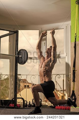Man With Torso, Muscular Man Exercise With Trx Loops, Window On Background. Sportsman, Athlete Looks