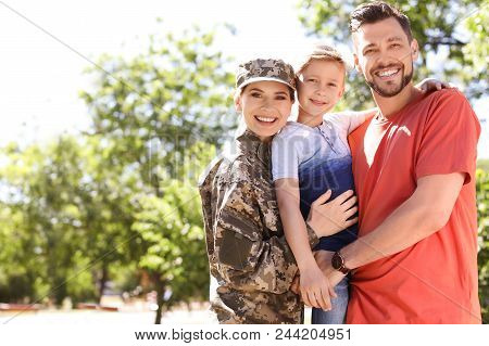 Female Soldier With Her Family Outdoors. Military Service