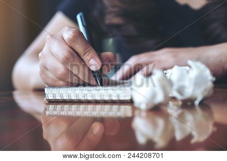Closeup Image Of A Businesswoman Working And Writing Down On A White Blank Notebook With Screwed Up