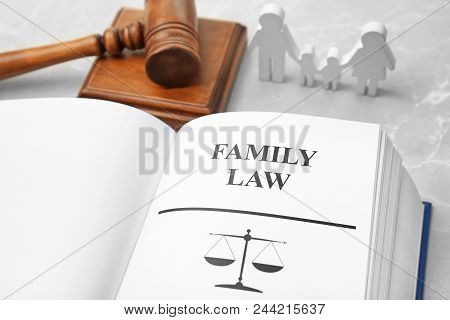 Open Book With Words Family Law And Gavel On Table, Closeup