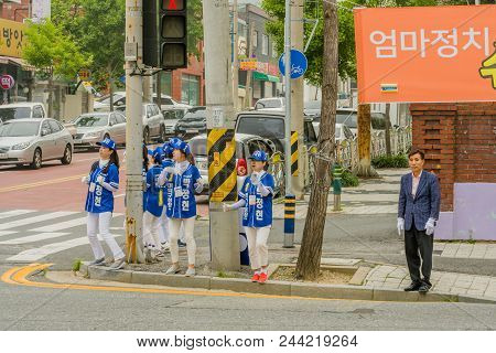 Daejeon, South Korea; June 7, 2018: Campaign Volunteers Standing On Corner Dancing In Support For Pa