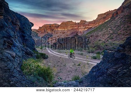 Mountain Biker At The Desert