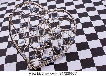 A Heart Cage On A Checked Background
