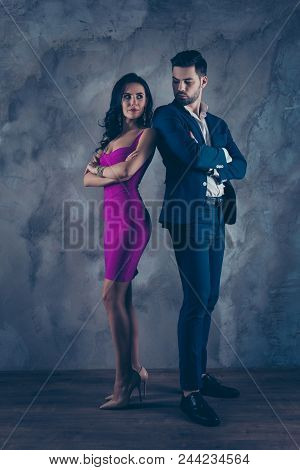 Full Size Fullbody Vertical Portrait Of Attractive Confident Couple With Crossed Arms Looking At Eac