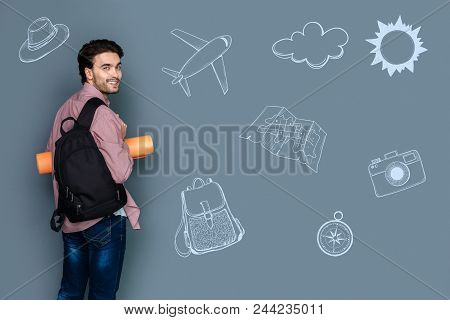 Travelling Abroad. Cheerful Young Tourist Feeling Confident And Turning With A Smile While Travellin