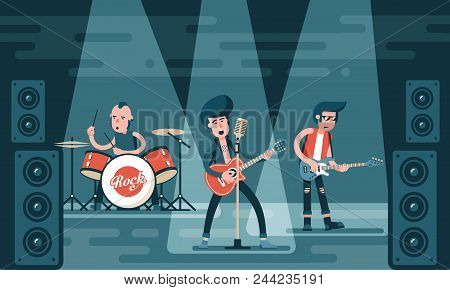 Concert Of Rock Band On Stage. Singing Guitarist, Bass Guitar Player, Drummer In Stylish Clothes. Ca