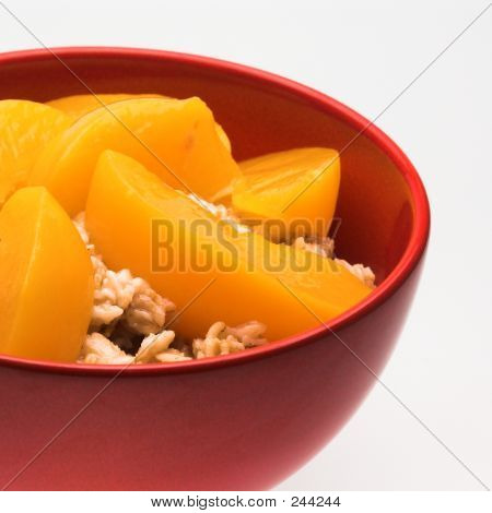Bowl Of Oatmeal With Peaches (close View)