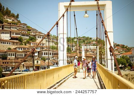 Berat, Albania - June 2018: Tourists Passing Modern Bridge In Historical Town Berat, In Albania, Une