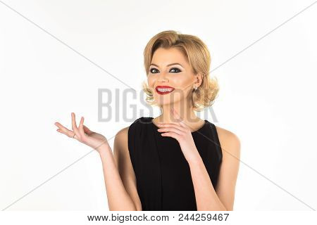 Blonde Girl With Evening Make-up On White Background. Beautiful Makeup And Black Dress. Skin And Fac