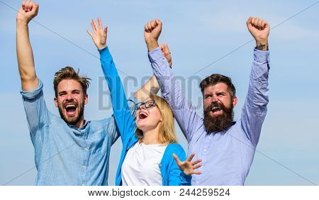 Freedom Concept. Company Three Happy Colleagues Office Workers Enjoy Freedom, Sky Background. Employ