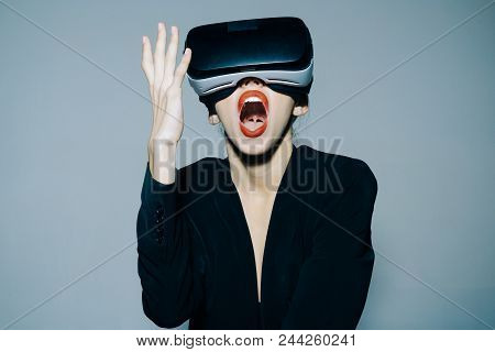 Virtual Reality Is Our Future. Emotional Smile Happy Woman Wearing Virtual Reality Goggles. Attracti