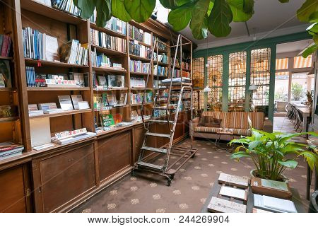 Hague, The Netherlands - Apr 6: Bookstore With Antique Bookshelves, Decoration, Couch And Table For