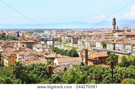 cityscape view of Florence or Firenze city Italy - Ponte Vecchio birdge and Palazzo Vecchio view poster