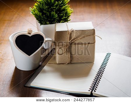 Birth Day And Important Day Background Concept. Coffee Cup With Gift Box, Heart Tag, Notebook And Gl
