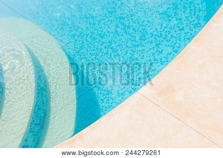 Clear Blue Water In The Pool. Part Of The Pool Closeup. Step Into The Water And Finish The Pool Bott