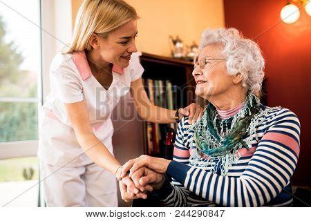 Nurse Visit Her Senior Patient At Home