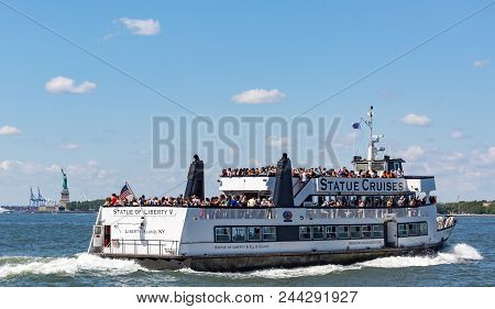 New York City, Usa - 9 July 2017: A Statue Cruises Tour Boat In Front Of The Statue Of Liberty. Larg