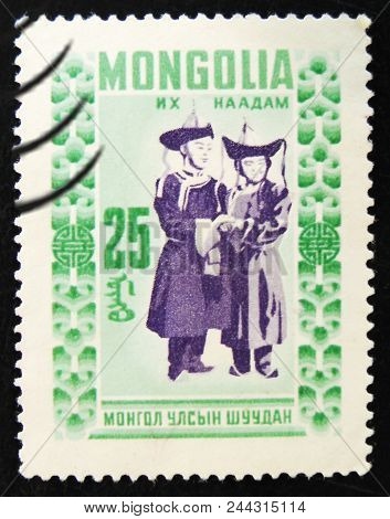 Moscow, Russia - April 2, 2017: A Post Stamp Printed In Mongolia Shows Two Mongolian People In Ethni