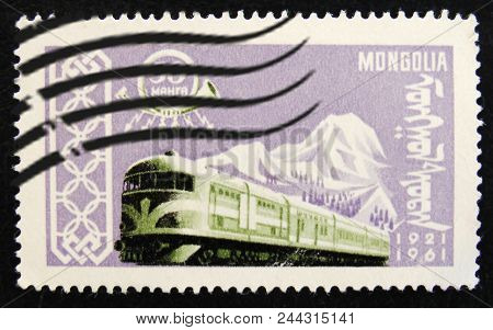 Moscow, Russia - April 2, 2017: A Post Stamp Printed In Mongolia Shows Electric Train, Circa 1961