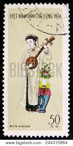 Moscow, Russia - April 2, 2017: A Post Stamp Printed In Vietnam Shows Woman Playing Banjo, Circa 197