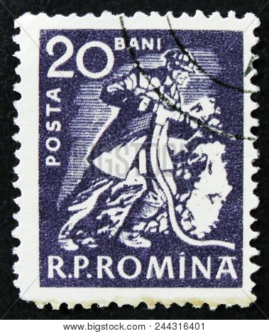 Moscow, Russia - April 2, 2017: A Post Stamp Printed In Romania Shows Miner, Circa 1960