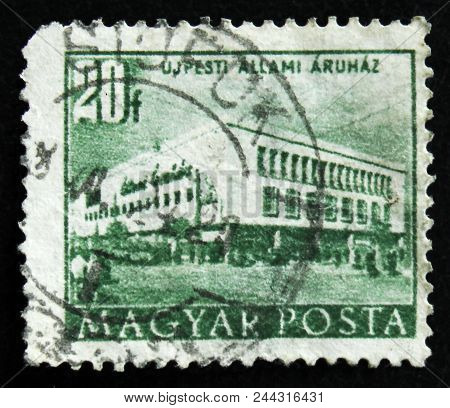 Moscow, Russia - April 2, 2017: A Post Stamp Printed In Hungary Shows Department Store In Ujpest Cit