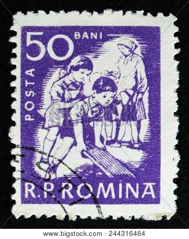 Moscow, Russia - April 2, 2017: A Post Stamp Printed In Romania Shows Children At Play, Circa 1960