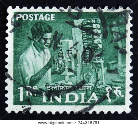 Moscow, Russia - April 2, 2017: A Post Stamp Printed In India Shows Man Working In A Factory, Series