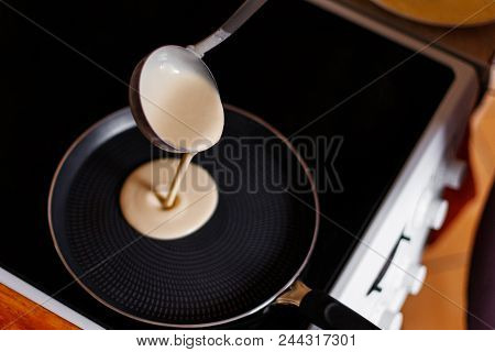 Cooking Pancakes In A Frying Pan. The Cooking Process In The Kitchen.