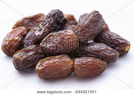 Dried Dates On A White Background, Arab Palm Fruit