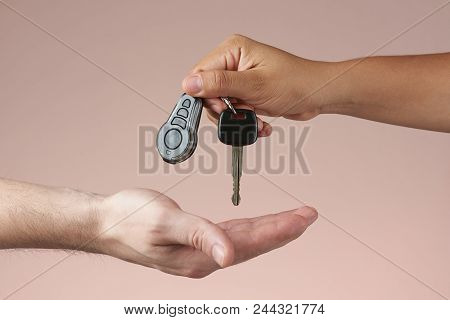 Giving Car Keys Concept. Hand Holding Auto Keys. Sell Vehicle Service. Hands Hanging Keys Isolated