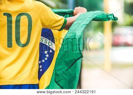 Brazilian Boy Holding The Flag Of Brazil
