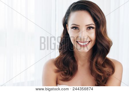 Cheerful Positive Beautiful Bride With Wavy Hair And Perfect Makeup Excited About Wedding Looking At