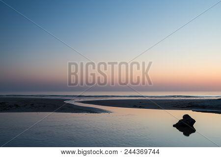 Stunning Colorful Vibrant Sunrise Over Low Tide Beach Landscape Peaceful Scene