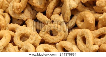 Background Of Handmade Tarallins Called Tartalli Or Tarallini In Italian Language Of A Bakery In Sou