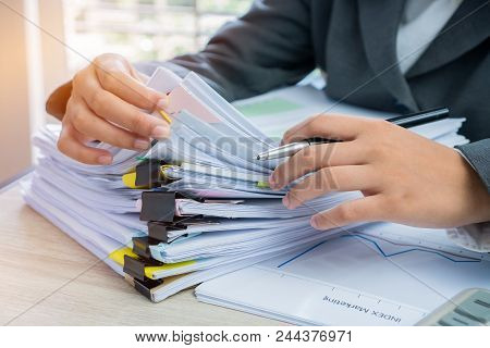 Hands Young Female Business Managers Checking And Arranging Stack Of Unfinished Documents Reports Pa