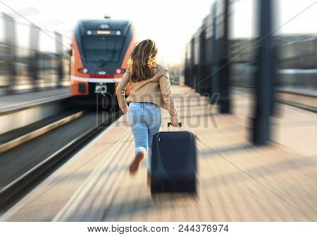 Woman Late From Train. Tourist Running And Chasing The Leaving Train In Station. Person With Stress