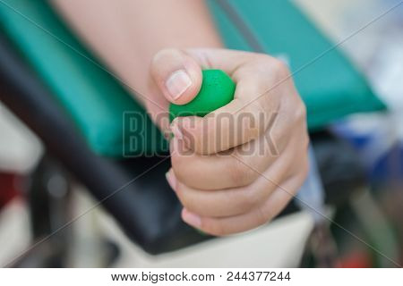 Health And Medical : Blood Donor Donation With Bouncy Ball Holding In Hand. Blood Donation Occurs Wh