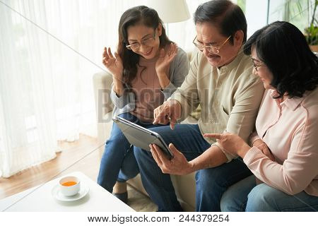 Senior People With Touchpad Spending Time Together