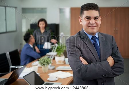 Waist-up Portrait Of Confident Middle-aged Businessman Wearing Elegant Suit Posing For Photography W