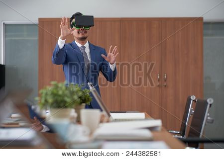 Smiling Bearded Designer Wearing Elegant Suit Using Vr Headset While Working With 3d Visualization,