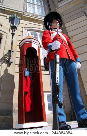 Copenhagen, Denmark, March 16, 2010: The Guards Of Honour In Red Galla Uniform Guarding The Royal Re
