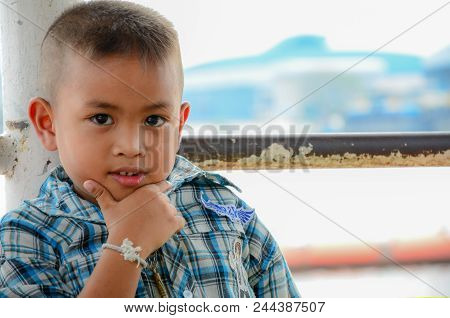 Samutsakorn, Thailand - Feb 25, 2013: Unidentified Thai Boy With A Happy Expression And A Photo Take