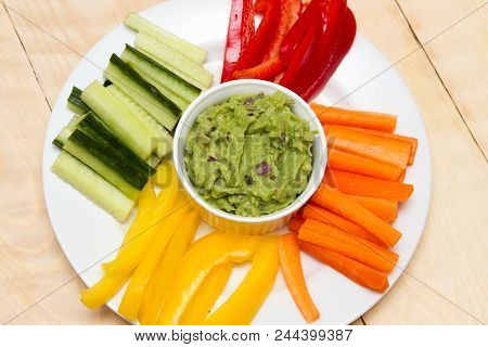 Guacamole Dip A Starter Of Guacamole And Different Dips Carrot, Pepper And Cucumber