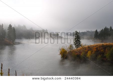 Autumn Mist Over Bridge and Lake