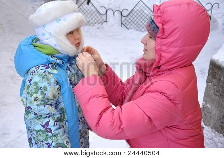 Portrait Of A Mother And Daughter In Winter