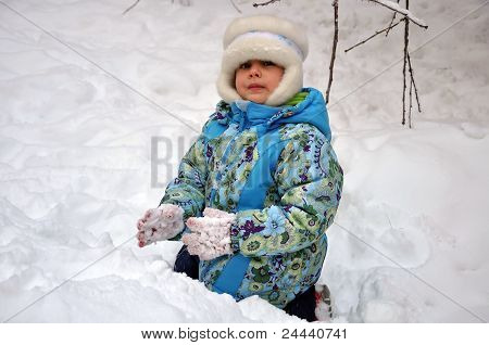 Little Girl On The Snow